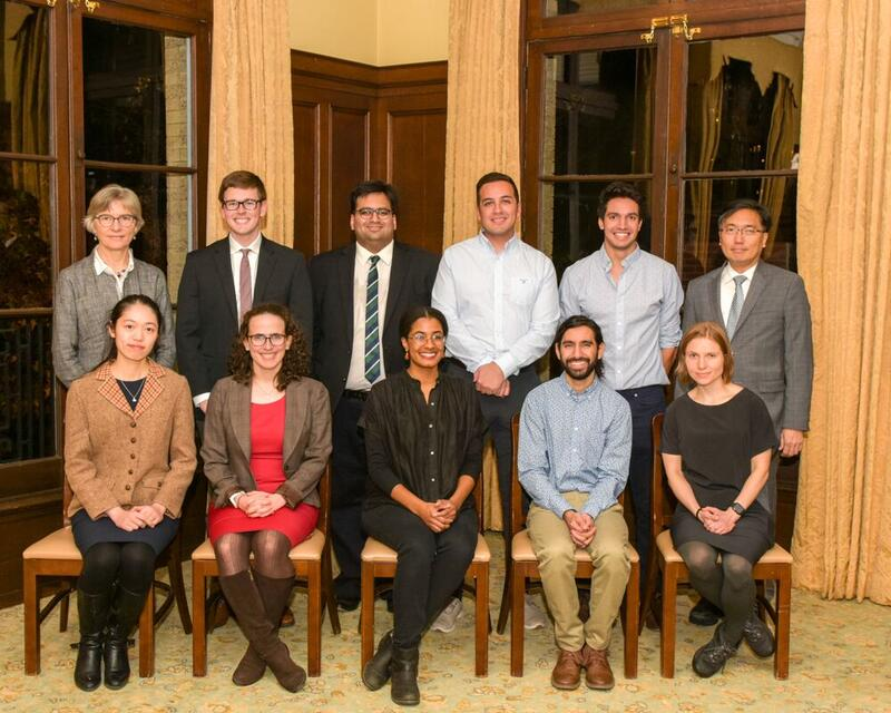 Prize Teaching Fellow Recipients Awarded in 2019-20 for Teaching in 2018-19. Pictured at the Fall 2019 Dinner Are: (Seated, From Left to Right) Yingqi Tang (Political Science), Sarah Zager (Religious Studies), Cera Smith (English Language & Literature), Samuel Bhutto (Chemistry), Lucia Hulsether (Religious Studies); (Standing, From Left to Right) Lynn Cooley, Dean of Graduate School of Arts & Sciences, Brandon Hubbard (Cellular & Molecular Physiology), Ahyan Panjwani (Economics), Javier Portillo (Molecular,